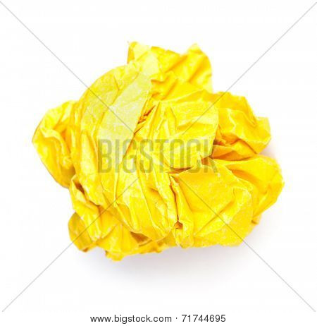 Screwed up piece of yellow paper isolated