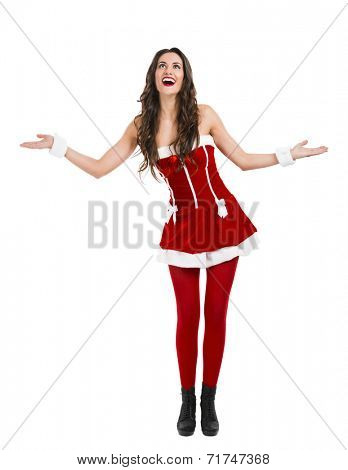 Beautiful and sexy woman wearing santa clause costume with arms open
