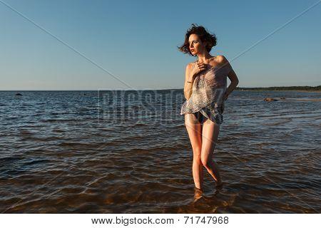 Seminude Woman Against Sea Background