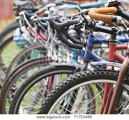 Photo of Miscellaneous Bikes Parked at a Bike Rack poster