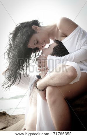 Young beautiful couple having romantic fun on the beach
