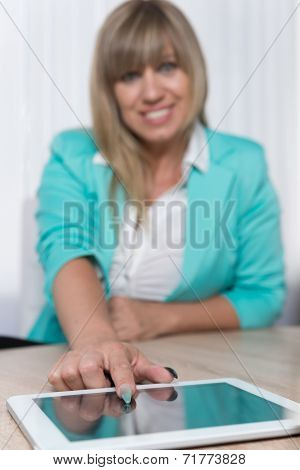 Woman Is Pointing At A Tablet