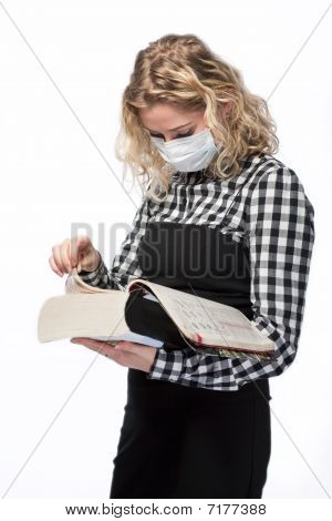 blond with encyclopedia in medical mask
