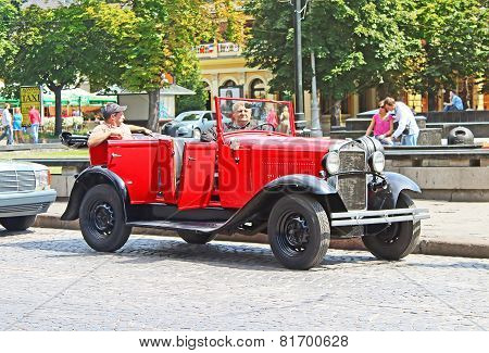 Retro Car On The Street In Lviv On The Frame Of Classic Car Festival