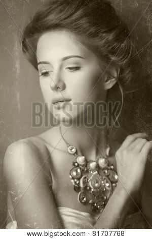 Portrait of edwardian woman with necklace. Photo in old image style.