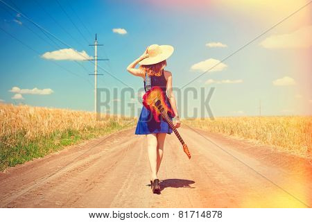 Rock Girl With Guitar At Countryside.