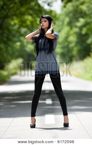 Young Lady Standing In The Street