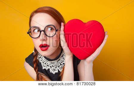 Nerd redhead girl with heart shape on yellow backgorund. poster