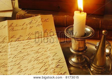 Old handwriting on parchment, from 1800's in English with candle illuminating poster