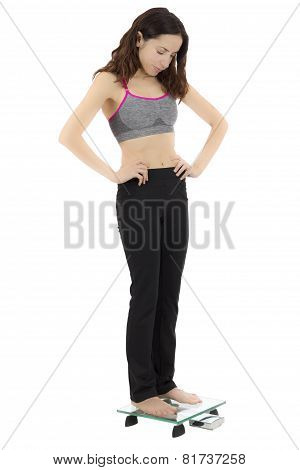 Woman Measuring Her Weight Unhappy About The Result