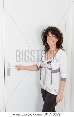 Brunette Woman  In Front Of The Door, Waiting