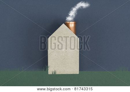 Conceptual House With Billowing Smoke
