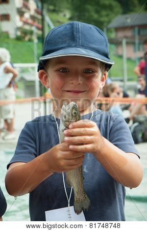 Happy Child With A Trout