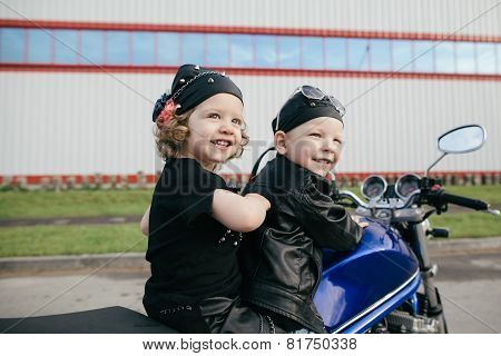 cute little bikers on road with motorcycle poster