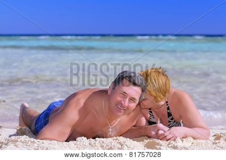 Mature Couple On The Beach In The Tropics.