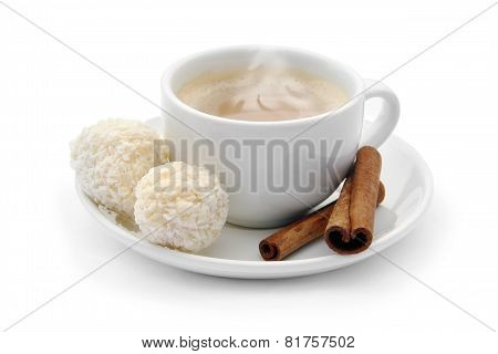 Cup Of Coffee With Chocolate Candies And Cinnamon
