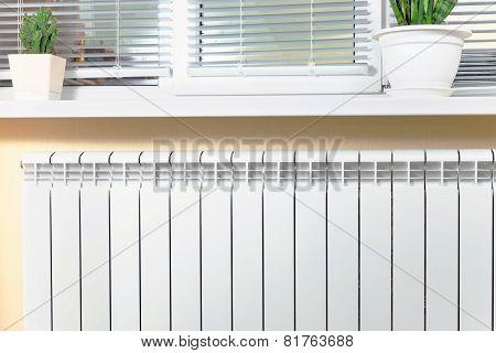Heating White Radiator Radiator With Flower And Window.