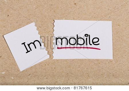 Sign With Word Immobile Turned Into Mobile