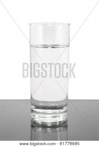 Glass Of Clean Water On White- Gray Background.
