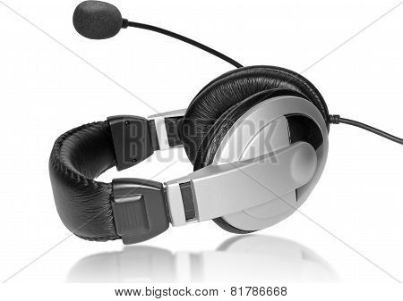 Big Headset With A Microphone. On Plate Glass