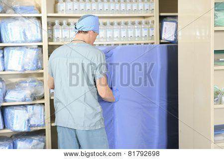 Medical staff sterilizing hands and arms before surgery poster