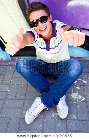 Young man with thumbs up