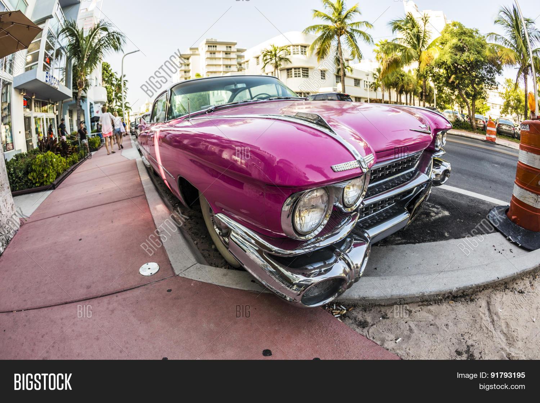 Cadillac Vintage Car Parked At Ocean Drive In Miami Beach