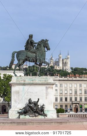 Famous Statue And Fourviere Basilica On A Background In Lyon City