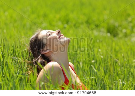 Happy Girl Face Breathing Fresh Air In A Meadow