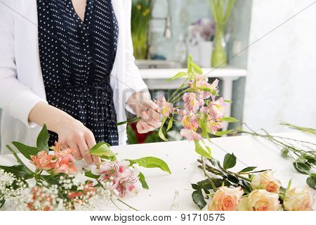 A Florist Combining Flowers