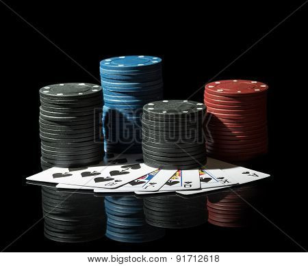 Colorful poker chips with cards