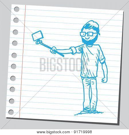Hipster man taking selfie holding selfie stick