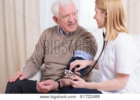 Caregiver Checking The Hypertension