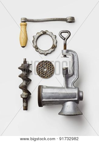 Metal meat grinder well arranged over white background above view poster