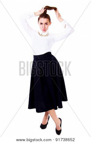 Beautiful young woman in a white blouse and a long black skirt isolated over white background poster