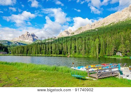 Peaceful lake with padal boat pier and Tre Cime