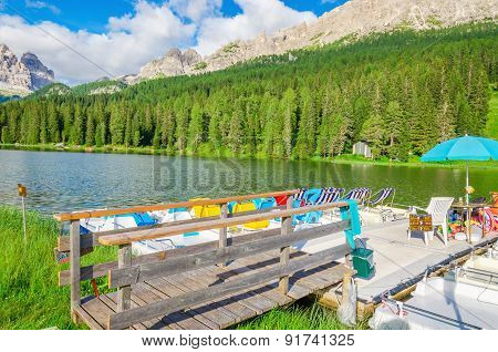 Colored pedalos on the Lake Misurina in Italy