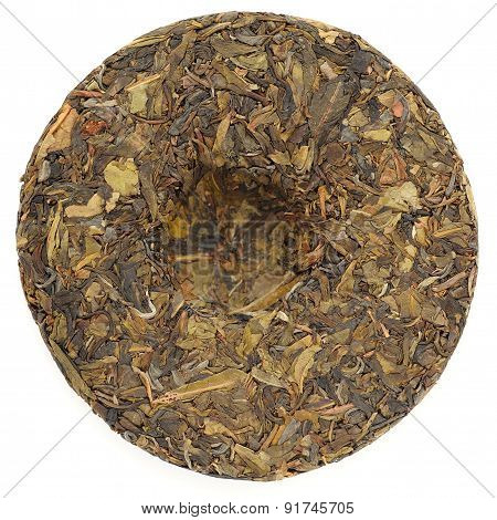 Jingmai Gu Shu Huang Pian Raw Puerh Tea In Round Shape Isolated Top View
