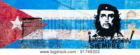 HAVANA,CUBA - MAY 25,2015 : Cuban flag and Che Guevara painted on a grunge old wall in Havana
