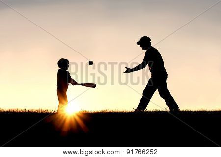 Silhouette Of Father And Son Playing Baseball Outside