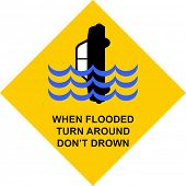 "Yellow traffic sign with warning ""when flooded turn around don't drown"" with a car sinking in high water poster"