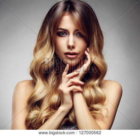 Beautiful blonde woman with long, healthy , straight and shiny hair. Hairstyle loose hair