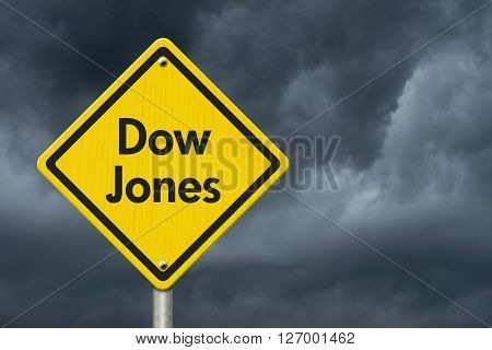 Yellow Warning Highway Sign with words Dow Jones with stormy sky background