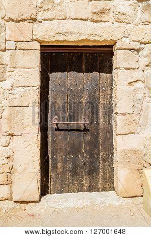 The old wooden door in the ancient nabatean town Shivta in the Negev desert, Israel