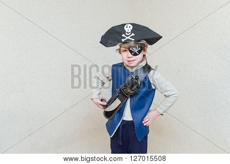 child boy playing pirate. Pirate costume on a child. The captain of a pirate ship.