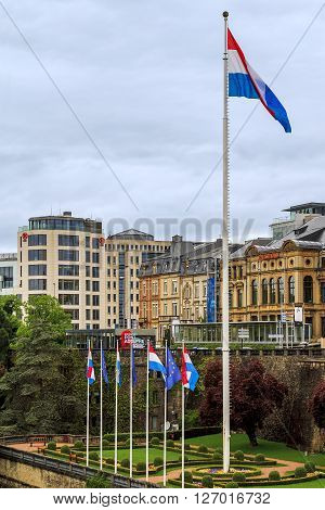 Luxembourg, Luxembourg - May 5: It is a park in the valley of the river Petrus with a flag of Luxembourg on a huge flagpole May 5, 2013 in Luxembourg, Luxembourg.