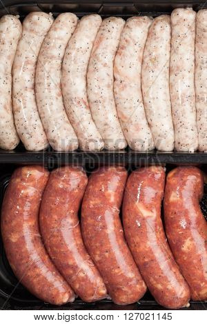 raw meat sausages in the container