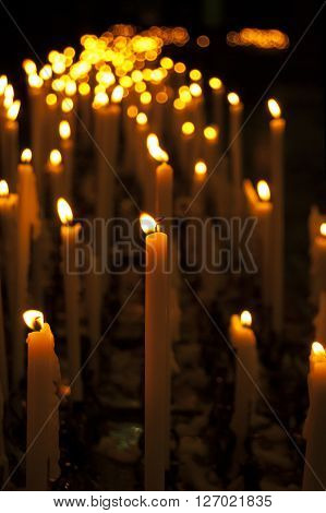 Lot Of Thin Burning Candles, Dark Background