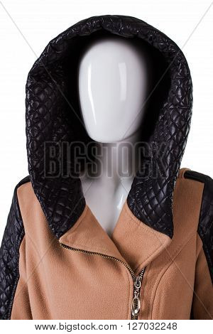 Brown coat with quilted hood. Female mannequin wearing hooded coat. Garment with dark leather hood. Seasonal sale in boutique.