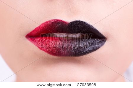 Beautiful red dark glossy lips close-up, macro photography